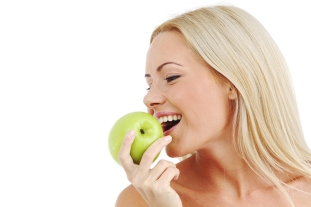 012- bigstock-blond-woman-eat-green-apple-12516284